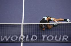 Rafael Nadal of Spain falls down behind the net during his semi-final match against Jo-Wilfried Tsonga of France, in the Shanghai Tennis Masters at the Qi Zhong Tennis Center in Shanghai, China, 17 October 2015. (España, Tenis, Francia) EFE/EPA/ROLEX DELA PENA