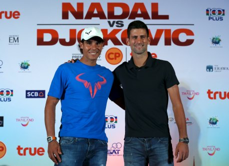 "Novak Djokovic of Serbia (R) and Rafael Nadal of Spain pose after a news conference ahead of Friday's tennis friendly match called ""Back To Thailand - Nadal vs Djokovic"" event at a hotel in Bangkok, Thailand, October 1, 2015. REUTERS/Chaiwat Subprasom"