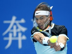 Rafa Nadal of Spain hits a return against Fabio Fognini of Italy during their men's singles semifinal match at the China Open tennis tournament in Beijing, China, October 10, 2015. REUTERS/Kim Kyung-Hoon