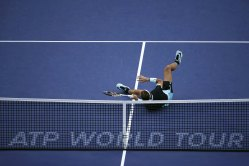 Rafael Nadal of Spain falls after returning a shot to Jo-Wilfried Tsonga of France during their men's singles semi-final match at the Shanghai Masters tennis tournament in Shanghai, China, October 17, 2015. REUTERS/Aly Song