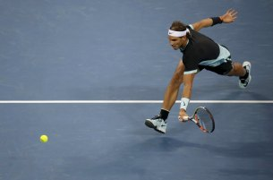 Rafa Nadal of Spain reaches for a return to Novak Djokovic of Serbia during the men's singles final match at the China Open Tennis Tournament in Beijing, China, October 11, 2015. REUTERS/Jason Lee