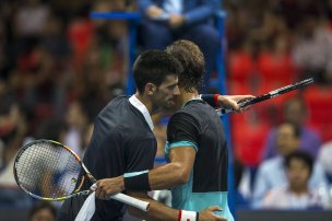 "Novak Djokovic of Serbia (L) hugs Rafael Nadal of Spain after their ""Back To Thailand - Nadal vs Djokovic"" friendly tennis match in Bangkok, Thailand, October 2, 2015. REUTERS/Athit Perawongmetha"