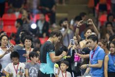 "Rafael Nadal of Spain signs autographs for fans after his ""Back To Thailand - Nadal vs Djokovic"" friendly tennis match in Bangkok, Thailand, October 2, 2015. REUTERS/Athit Perawongmetha"