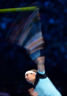 Rafael Nadal serves to Novak Djokovic during their semi-final clash at the ATP World Tour Finals in London on November 21, 2015 (AFP Photo/Glyn Kirk)