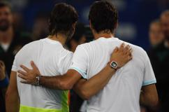 Roger Federer, right, of the UAE Royal and Rafael Nadal of the Indian Aces pose for a picture after the men's singles event of the International Premier Tennis League in New Delhi, India, Saturday, Dec. 12, 2015. (AP Photo /Tsering Topgyal)