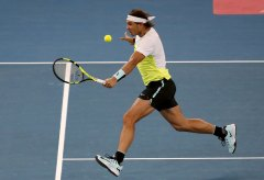 Indian Aces' Rafael Nadal of Spain hits a return to Philippine Mavericks' Edouard Roger-Vasselin of France (unseen) during their men's singles match in the International Premier Tennis League (IPTL) in New Delhi, India, December 10, 2015. REUTERS/Anindito Mukherjee