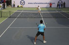 Spain's Rafael Nadal plays with an Indian fan during a promotional event in New Delhi, India, Thursday, Dec. 10, 2015. Nadal, who plays for Indian Aces in the International Professional Tennis League (IPTL), is in India to play a leg of the league. (AP Photo/Altaf Qadri)