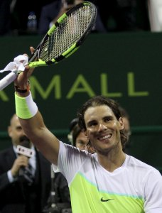 Rafael Nadal of Spain celebrates after winning his Qatar Open men's singles tennis match against Robin Haase of the Netherlands in Doha, Qatar January 6, 2016. REUTERS/Naseem Zeitoon