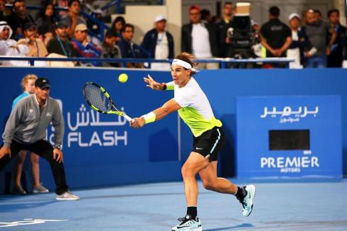 Spain's Rafael Nadal returns the ball to Milos Raonic of Canada during their final match of the Mubadala World Tennis Championship in Abu Dhabi, United Arab Emirates, 02 January 2016. (Tenis) EFE/EPA/ALI HAIDER