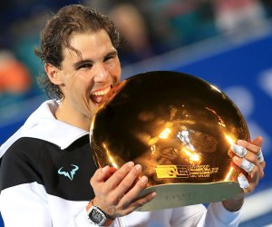 Rafael Nadal of Spain celebrates after winning the Mubadala World Tennis Championship in Abu Dhabi, January 2, 2016. REUTERS/Stringer FOR EDITORIAL USE ONLY. NO RESALES. NO ARCHIVE.