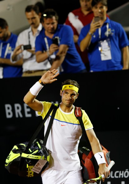 Rafael Nadal of Spain, greets spectators as he arrives for his match against Pablo Carreno of Spain, at the Rio Open tennis tournament, in Rio de Janeiro, Brazil, Tuesday, Feb. 16, 2016. (AP Photo/Silvia Izquierdo)