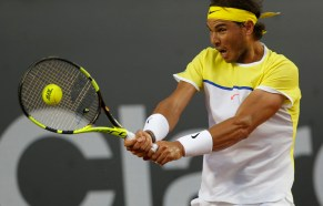 Rafael Nadal of Spain returns the ball to Nicolas Almagro of Spain, during a Rio Open tennis match, in Rio de Janeiro, Brazil, Thursday, Feb. 18, 2016. (AP Photo/Silvia Izquierdo)