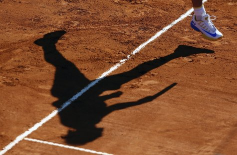 Spain's Rafael Nadal casts his shadow as he serves during his tennis match against Italy's Paolo Lorenzi at the ATP Argentina Open in Buenos Aires, February 12, 2016. REUTERS/Marcos Brindicci