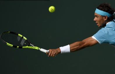 Rafael Nadal, of Spain, reaches to return to Fernando Verdasco, of Spain, during the BNP Paribas Open tennis tournament, Tuesday, March 15, 2016, in Indian Wells, Calif. (AP Photo/Mark J. Terrill)