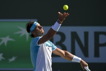Rafael Nadal, of Spain, serves to Alexander Zverev, of Germany, during the BNP Paribas Open tennis tournament, Wednesday, March 16, 2016, in Indian Wells, Calif. (AP Photo/Mark J. Terrill)