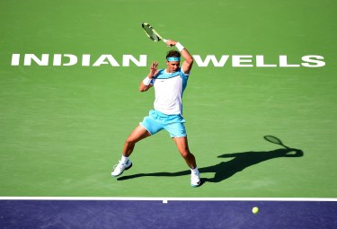INDIAN WELLS, CA - MARCH 19: Rafael Nadal of Spain returns a forehand in his loss to Novak Djokovic of Serbia during day thirteen of the 2016 BNP Parisbas Open at Indian Wells Tennis Garden on March 19, 2016 in Indian Wells, California. (Photo by Harry How/Getty Images)