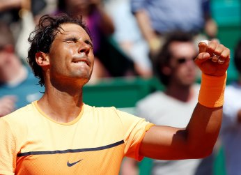 Tennis - Monte Carlo Masters - Monaco, 15/04/2016. Rafael Nadal of Spain reacts after winning his match against Stan Wawrinka of Switzerland. REUTERS/Eric Gaillard