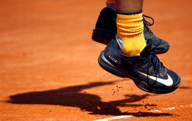 Tennis - Monte Carlo Masters - Monaco, 13/04/2016. The shoes of Rafael Nadal of Spain, emblazoned with the date of NBA player Kobe Bryant's last game, are seen during his match against Aljaz Bedene of Britain. REUTERS/Eric Gaillard