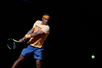 Spain's Rafael Nadal returns a ball to Andrey Kuznetsov, from Russia, during a Madrid Open tennis tournament match in Madrid, Spain, Tuesday, May 3, 2016. Nadal won 6-3, 6-3. (AP Photo/Francisco Seco)