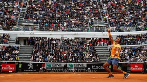 ROME, ITALY - MAY 13: Rafa Nadal of Spain in action against Novak Djokovic of Serbia during day six of the The Internazionali BNL d'Italia 2016 on May 13, 2016 in Rome, Italy. (Photo by Matthew Lewis/Getty Images)