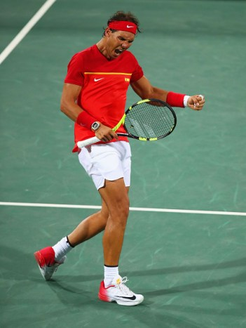 RIO DE JANEIRO, BRAZIL - AUGUST 08: Rafael Nadal of Spain celebrates match point and victory during the Men's Doubles second round match on against Juan Martin Del Potro and Maximo Gonzalez of Argentina Day 3 of the Rio 2016 Olympic Games at the Olympic Tennis Centre on August 8, 2016 in Rio de Janeiro, Brazil. (Photo by Clive Brunskill/Getty Images)