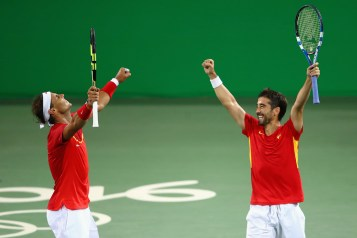 Rafael Nadal (L) and Marc Lopez of Spain celebrate defeating Oliver Marach and Alexander Peya of Austria in a Men's Doubles Quarterfinals match on Day 4 of the Rio 2016 Olympic Games at the Olympic Tennis Centre on August 9, 2016 in Rio de Janeiro, Brazil. (Aug. 8, 2016 - Source: Clive Brunskill/Getty Images South America)