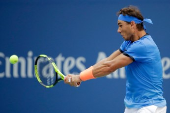 Rafael Nadal of Spain returns a shot to Lucas Pouille of France during his fourth round Men's Singles match on Day Seven of the 2016 US Open at the USTA Billie Jean King National Tennis Center on September 4, 2016 in the Flushing neighborhood of the Queens borough of New York City. (Sept. 3, 2016 - Source: Andy Lyons/Getty Images North America)