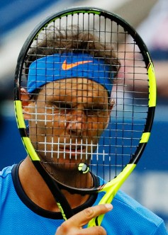 Rafael Nadal, of Spain, puts his racket to his face during play against Lucas Pouille, of France, during the fourth round of the U.S. Open tennis tournament, Sunday, Sept. 4, 2016, in New York. (AP Photo/Alex Brandon)