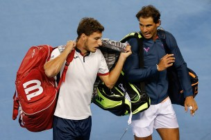 BEIJING, CHINA - OCTOBER 08: Rafael Nadal of Spian and Pablo Carreno Busta of Spain leave the court after winning against Mike Bryan of the United States and Bob Bryan of the United States during the Men's Double Semi Final match on day eight of the 2016 China Open at the China National Tennis Centre on October 8, 2016 in Beijing, China. (Photo by Etienne Oliveau/Getty Images)