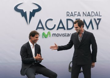 Switzerland's Roger Federer reaches out his hand to Spain's Rafael Nadal during the opening ceremony of the Rafa Nadal tennis academy in Manacor, Spain, October 19, 2016. REUTERS/Enrique Calvo