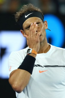 MELBOURNE, AUSTRALIA - JANUARY 25: Rafael Nadal of Spain reacts in his quarterfinal match against Milos Raonic of Canada on day 10 of the 2017 Australian Open at Melbourne Park on January 25, 2017 in Melbourne, Australia. (Photo by Cameron Spencer/Getty Images)