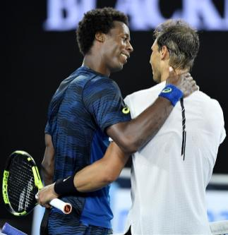 Spain's Rafael Nadal is congratulated by France's Gael Monfils after winning their fourth round match at the Australian Open tennis championships in Melbourne, Australia, Monday, Jan. 23, 2017. (AP Photo/Andy Brownbill)