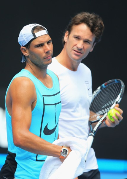 Rafael Nadal listens to coach Carlos Moya during a practice session ahead of the 2017 Australian Open at Melbourne Park on January 15, 2017 in Melbourne, Australia. (Michael Dodge/Getty Images)