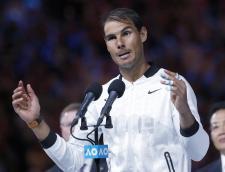 Spain's Rafael Nadal speaks after losing to Switzerland's Roger Federer in the men's singles final at the Australian Open tennis championships in Melbourne, Australia, Sunday, Jan. 29, 2017. (AP Photo/Dita Alangkara)