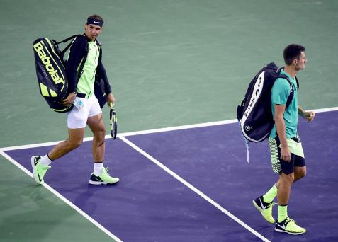 INDIAN WELLS, CA - MARCH 10: Rafael Nadal of Spain and Bernard Tomic of Australia take to the court to play in the men's doubles against Pablo Carreno Busta of Spain and Joao Sousa of Portugal at Indian Wells Tennis Garden on March 10, 2017 in Indian Wells, California. (Photo by Harry How/Getty Images)
