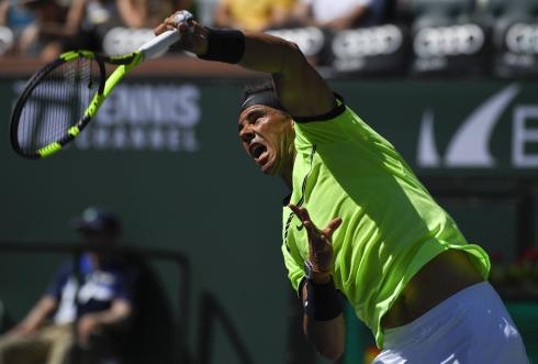Rafael Nadal, of Spain, serves to Guido Pella, of Argentina, at the BNP Paribas Open tennis tournament, Sunday, March 12, 2017, in Indian Wells, Calif. (AP Photo/Mark J. Terrill)