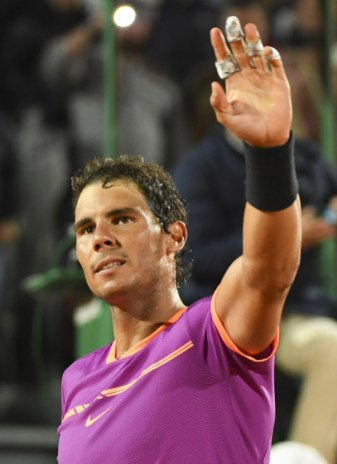 Spain's Rafael Nadal celebrates after winnining his match against Argentina's Diego Schwartzman during the Monte-Carlo ATP Masters Series Tournament tennis match, on April 21, 2017 in Monaco. / AFP PHOTO / Yann COATSALIOU (April 20, 2017 - Source: AFP)
