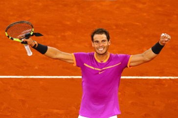 Rafael Nadal of Spain celebrates beating Nick Kyrgios of Australia on day six of the Mutua Madrid Open tennis at La Caja Magica on May 11, 2017 in Madrid, Spain. (May 10, 2017 - Source: Clive Rose/Getty Images Europe)