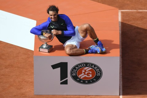 Spain's Rafael Nadal poses with the trophy after winning the men's final tennis match against Switzerland's Stanislas Wawrinka at the Roland Garros 2017 French Open on June 11, 2017 in Paris. / AFP PHOTO / GABRIEL BOUYS (June 10, 2017 - Source: AFP)