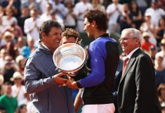 Rafael Nadal of Spain holds the trophy after victory with coach Toni Nadal looks on during the men's singles final against Stan Wawrinka of Switzerland on day fifteen of the French Open at Roland Garros on June 11, 2017 in Paris, France. (June 10, 2017 - Source: Julian Finney/Getty Images Europe)