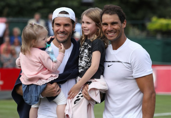 Tommy Haas holds his children alongside Rafael Nadal following their exhibition match during day four of the Aspall Tennis Classic at the Hurlingham Club, London. (Photo by Chris Radburn/PA Images via Getty Images)