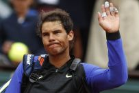 Spain's Rafael Nadal waves to spectators as as he leaves the court after his opponent Spain's Pablo Carreno Busta withdrew with an injury from their quarterfinal match of the French Open tennis tournament at the Roland Garros stadium, in Paris, France. Wednesday, June 7, 2017. (AP Photo/Petr David Josek)