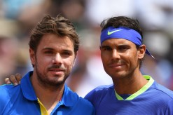 Switzerland's Stanislas Wawrinka (L) and Spain's Rafael Nadal pose before their final tennis match at the Roland Garros 2017 French Open on June 11, 2017 in Paris. / AFP PHOTO / Eric FEFERBERG (June 10, 2017 - Source: AFP)