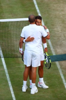 Rafael Nadal of Spain and Gilles Muller of Luxembourg embrace after their Gentlemen's Singles fourth round match on day seven of the Wimbledon Lawn Tennis Championships at the All England Lawn Tennis and Croquet Club on July 10, 2017 in London, England. (July 9, 2017 - Source: Clive Brunskill/Getty Images Europe)