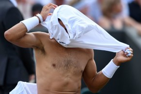 Spain's Rafael Nadal changes his t-shirt during a break in play against Luxembourg's Gilles Muller during their men's singles fourth round match on the seventh day of the 2017 Wimbledon Championships at The All England Lawn Tennis Club in Wimbledon, southwest London, on July 10, 2017. / AFP PHOTO / Glyn KIRK / RESTRICTED TO EDITORIAL USE (July 9, 2017 - Source: AFP)
