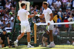 Rafael Nadal of Spain and John Millman of Australia shake hands after their Gentlemen's Singles first round match on day one of the Wimbledon Lawn Tennis Championships at the All England Lawn Tennis and Croquet Club on July 3, 2017 in London, England. (July 2, 2017 - Source: Michael Steele/Getty Images Europe)