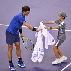 A ball kid gives a towel to Rafael Nadal of Spain in the match against Jared Donaldson of United States in their Men's Single match during Round 2 of 2017 ATP Shanghai Rolex Masters at Qizhong Stadium on October 10, 2017 in Shanghai, China. (Oct. 10, 2017 - Source: Kevin Lee/Getty Images AsiaPac)