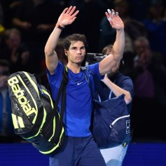 Spain's Rafael Nadal waves to the crowd after losing his singles match against Belgium's David Goffin on day two of the ATP World Tour Finals tennis tournament at the O2 Arena in London on November 13, 2017. / AFP PHOTO / Glyn KIRK