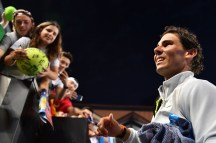 Spain's Rafael Nadal signs autographs after beating Bosnia's Damir Dzumhur in their men's singles third round match on day five of the Australian Open tennis tournament in Melbourne on January 19, 2018. / AFP PHOTO / SAEED KHAN / -- IMAGE RESTRICTED TO EDITORIAL USE - STRICTLY NO COMMERCIAL USE -- (Photo credit should read SAEED KHAN/AFP/Getty Images)