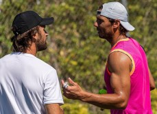 epa07653847 Spanish tennis player Rafa Nadal (R) chats with his coach, Carlos Moya (L), during a training session at the Country Club in Santa Posa, Mallorca, Spain, 17 June 2019, during the WTA Mallorca Open Tennis tournament. Nadal prepares for the All England Lawn Tennis Championships in Wimbledon. EPA-EFE/CATI CLADERA